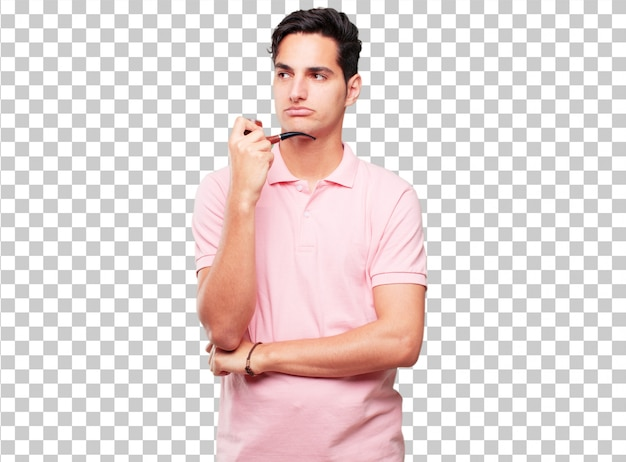 Jeune bel homme bronzé avec une pipe vintage de fumée