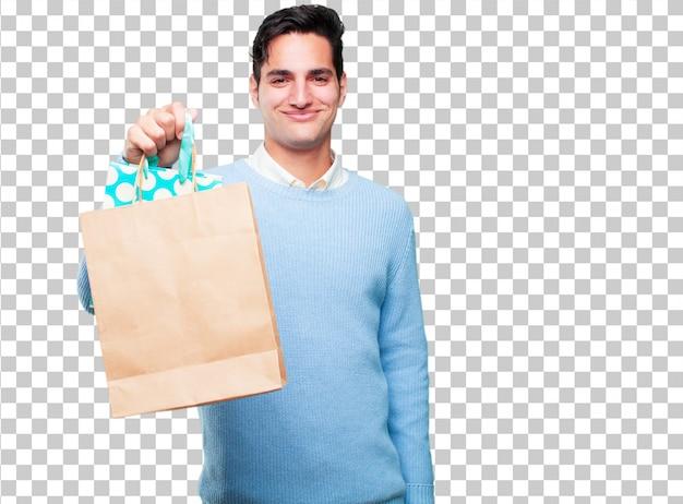 Jeune bel homme bronzé avec des sacs