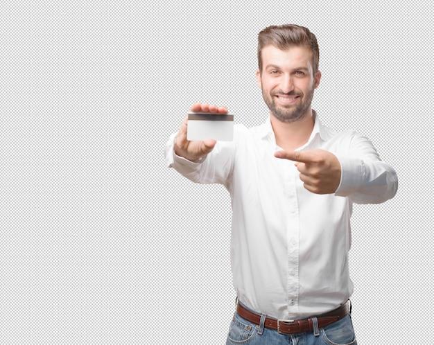 Jeune bel homme pointant sur la carte de crédit