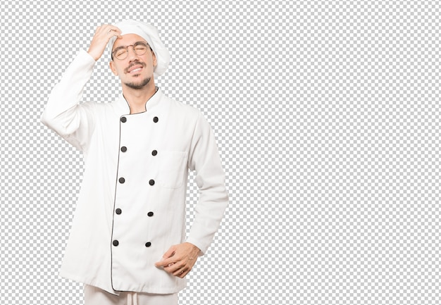 Jeune chef concerné faisant un geste de grattage