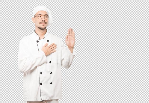 Jeune Chef Sérieux Avec Un Geste De Serment PSD Premium