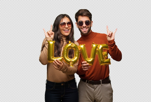 Jeune couple, saint valentin, faire, rocher, geste