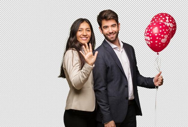 Jeune couple, saint valentin, montrer, numéro cinq