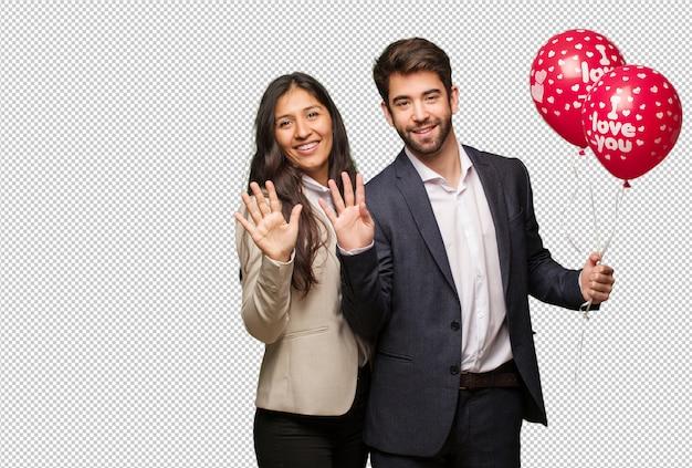 Jeune couple, saint valentin, montrer, numéro neuf