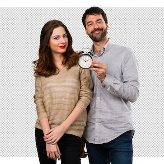 Jeune couple, tenue, vintage, horloge