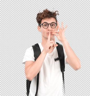 Jeune étudiant avec un geste de garder un secret