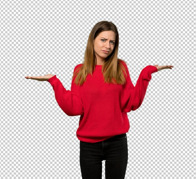 Jeune femme avec un pull rouge ayant des doutes tout en levant les mains