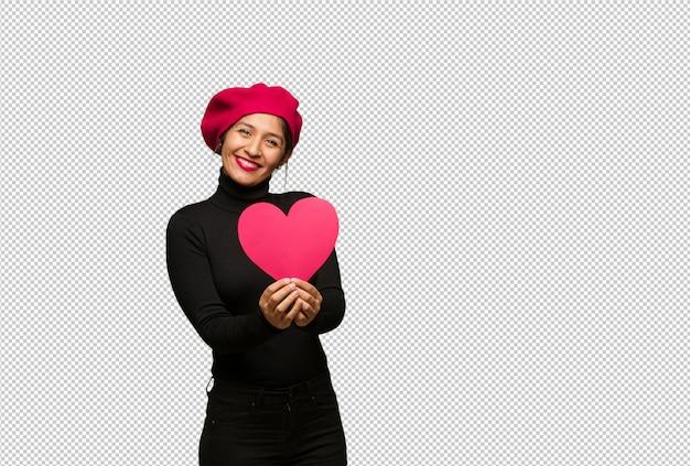 Jeune femme, saint valentin, faire coeur, à, mains