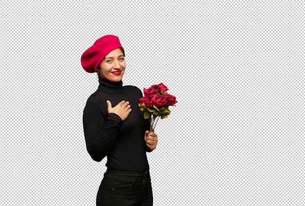 Jeune femme en saint valentin fait un geste romantique