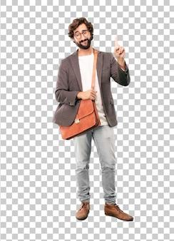 Jeune homme d'affaires barbu portant un blazer. fier ou expression de succès