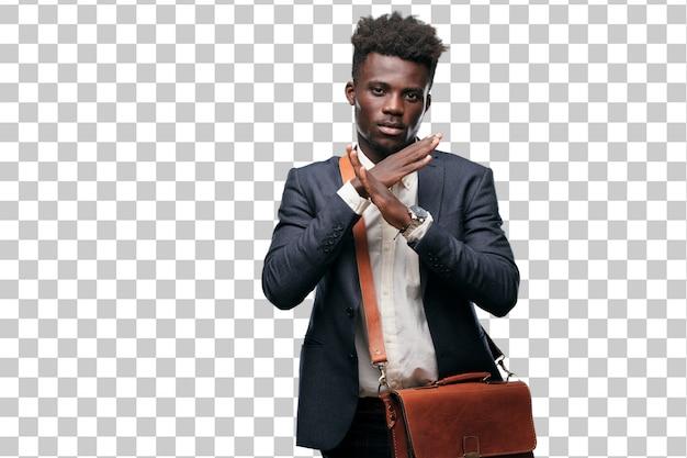 Jeune homme d'affaires noir avec les deux mains croisées devant la bouche