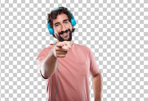 Jeune homme barbu souriant joyeusement et pointant en avant, vous choisissant.