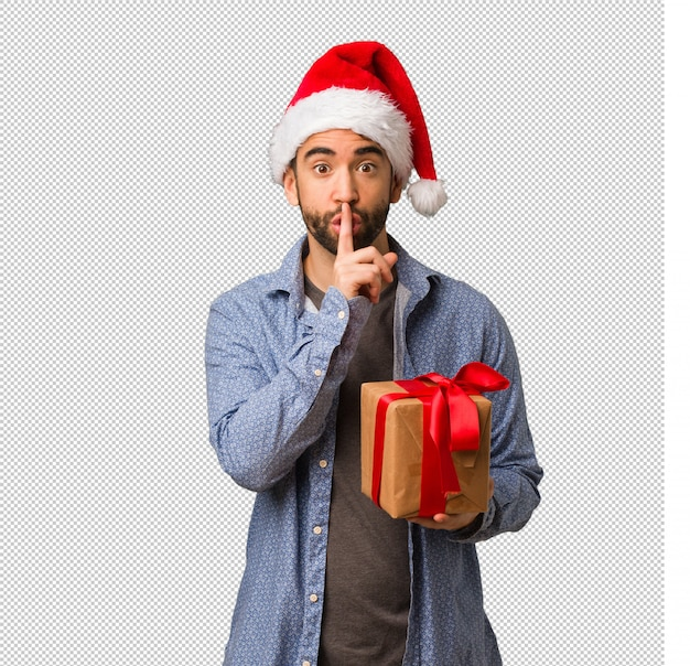 Jeune homme, porter, santa hat, garder secret, ou, demande, silence
