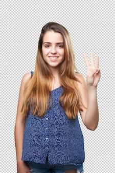 Jeune jolie femme faisant le geste numéro trois