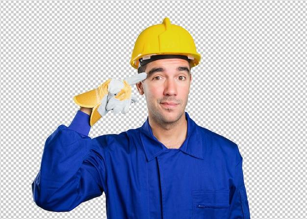 Jeune travailleur avec un geste de concentration sur fond blanc