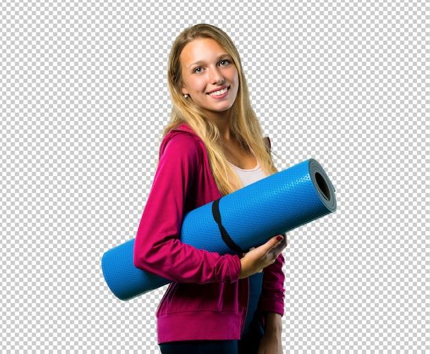 Jolie femme de sport avec tapis