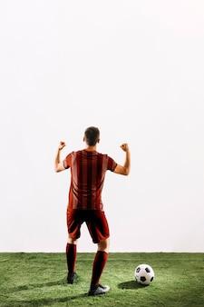 Joueur de football célébrant