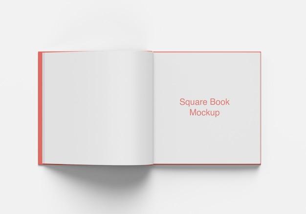 Livre carré ouvert ou vue d'angle de dessus de maquette de magazine