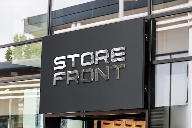 Logo 3d avec éclat réfléchissant sur une maquette de devanture de magasin