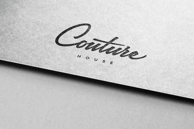 Logo blanc maquette papier texturé