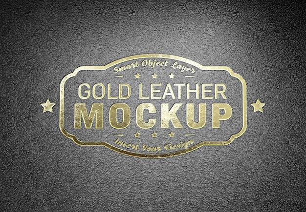 Logo doré en relief maquette sur cuir noir