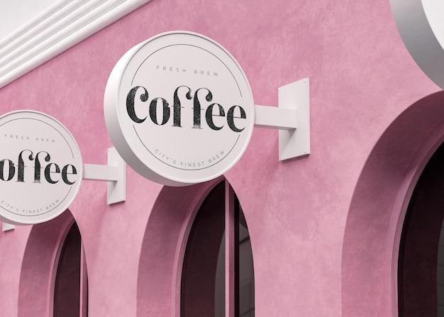 Logo maquette signe circulaire blanc sur magasin moderne rose