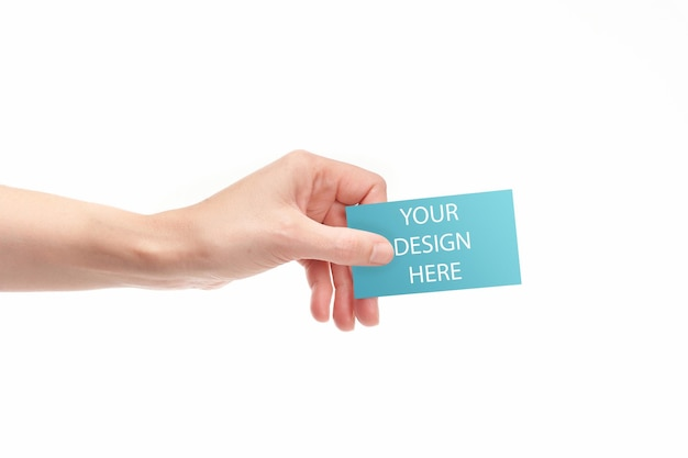 Main avec carte de visite et avec espace de copie