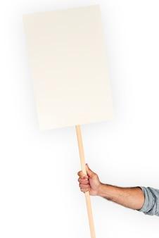 Main humaine tenant une bannière