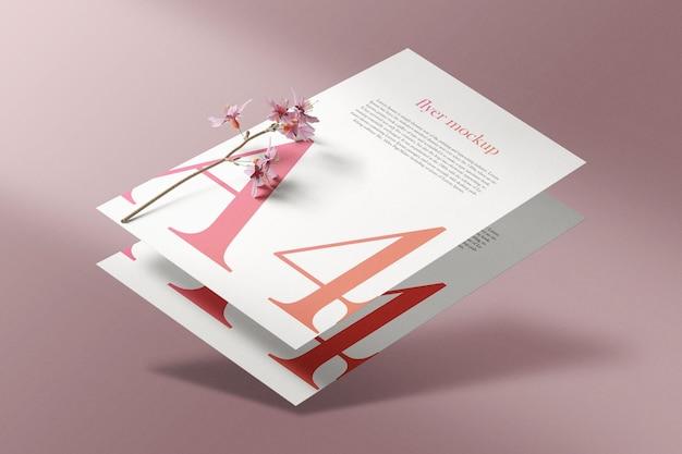 Maquette a4 en papier minimal et propre flottant avec une fleur de plante