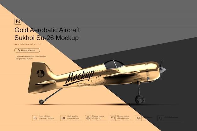 Maquette aerobatic gold aircraft