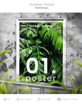 Maquette d'affiche de film en plein air rustique sur mur de béton avec superposition de feuilles