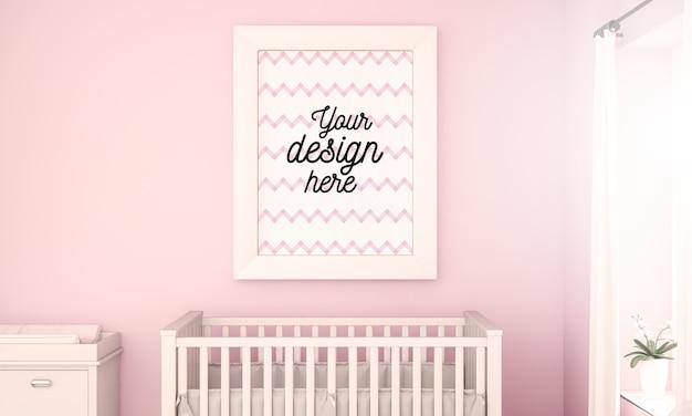 Maquette d'affiche sur le mur de la chambre de bébé rose