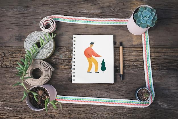 Maquette bloc-notes avec concept de jardinage