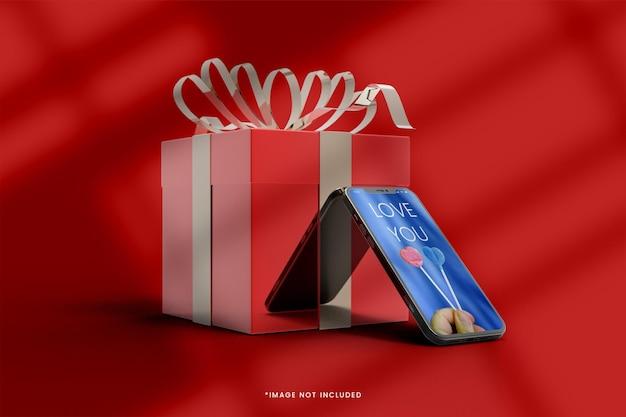Maquette de boîte cadeau 3d rose avec smartphone