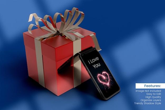 Maquette de boîte-cadeau de rendu 3d de la saint-valentin avec maquette de smartphone