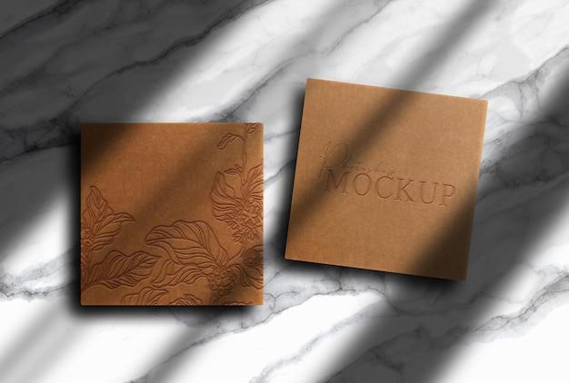 Maquette de boîtes en papier brun de luxe en relief