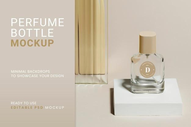Maquette de bouteille de parfum psd avec toile de fond de produit de texture de verre à motifs