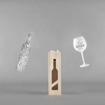 Maquette de bouteille de vin avec boite et verre