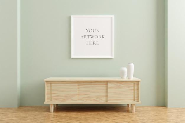 Maquette de cadre d'affiche carrée blanche sur une table en bois à l'intérieur du salon sur fond de mur de couleur pastel vide. rendu 3d.