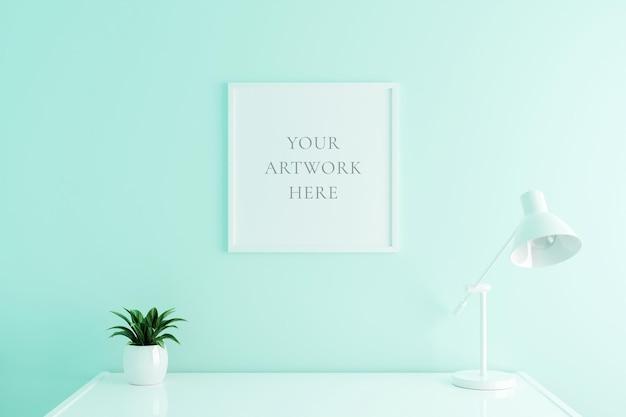 Maquette de cadre d'affiche carrée blanche sur la table de travail à l'intérieur du salon sur fond de mur de couleur blanche vide. rendu 3d.