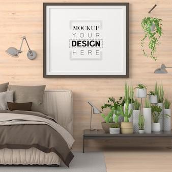 Maquette de cadre d'affiche dans une chambre