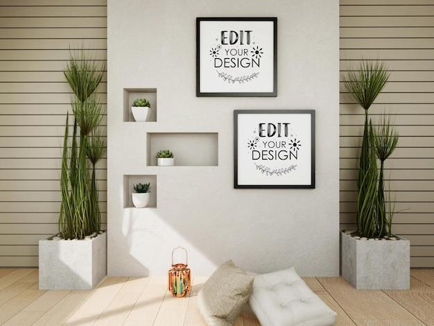 Maquette de cadre d'affiche sur le mur avec plante