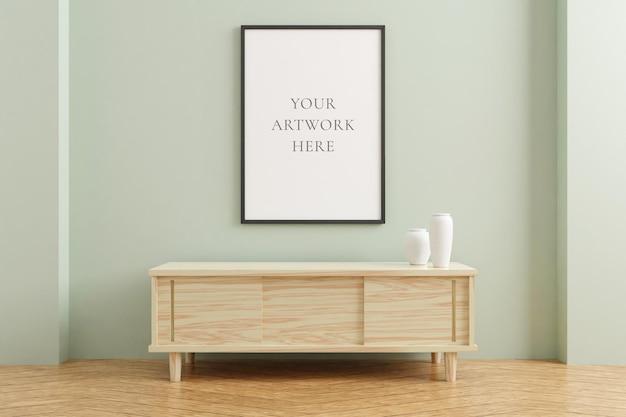 Maquette de cadre d'affiche vertical noir sur une table en bois à l'intérieur du salon sur fond de mur de couleur pastel vide. rendu 3d.
