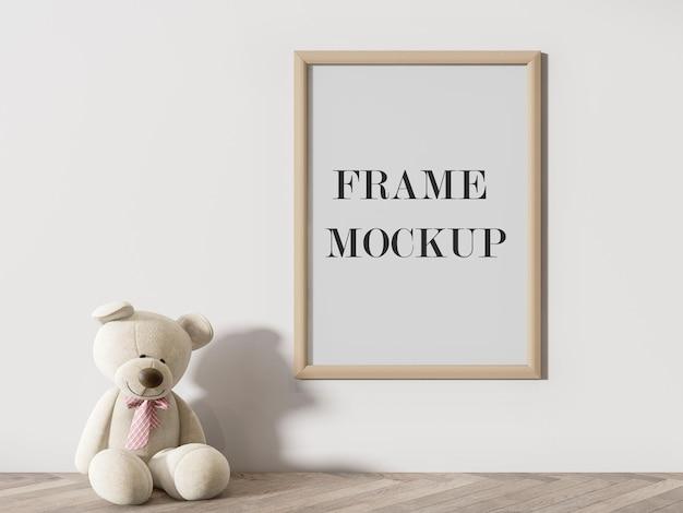 Maquette de cadre en bois avec ours en peluche