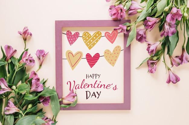 Maquette de cadre avec le concept floral saint valentin