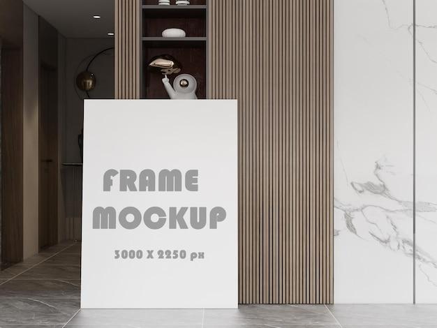 Maquette de cadre devant une étagère en bois