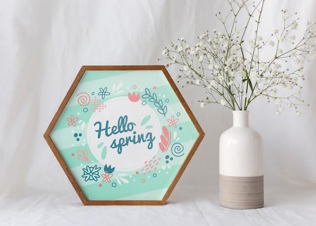 Maquette de cadre avec des fleurs de printemps