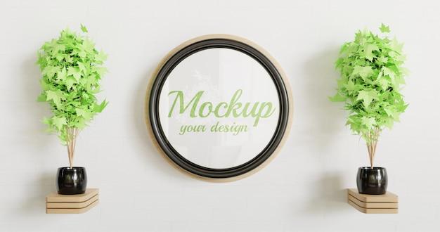 Maquette de cadre noir cercle sur le mur blanc avec décoration murale en bois