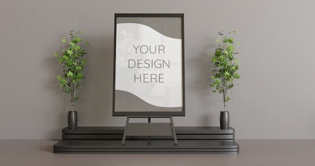 Maquette de cadre noir sur le chevalet avec quelques plantes de décoration, maquette de cadre horizontal.