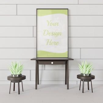 Maquette de cadre noir debout sur la mini table avec quelques succulentes